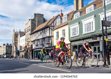 Cambridge, UK -  September 2018. People cycling on the road in Bridge street, Central Cambridge on a summer sunny day.
