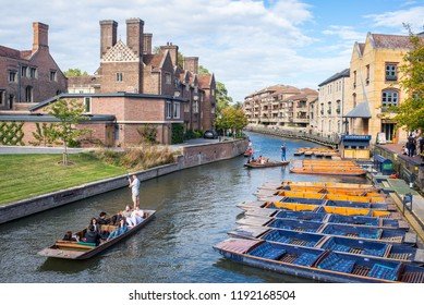 Cambridge, UK -  September 2018. Summer tourist punting on the river Cam, view from Magdalene bridge  with Magdalene College and Scudamore's Quayside Punting Station