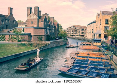 Cambridge, UK -  September 2018. Summer tourist punting on the river Cam, view from Magdalene bridge  with Magdalene College and Scudamore's Quayside Punting Station. Vintage matte effect