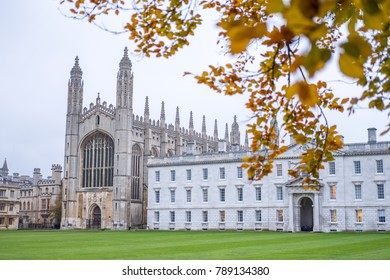Cambridge, United Kingdom - 15 November 2017: Blurred image of Yellow Autumn leaves with King's College, University of Cambridge in the background