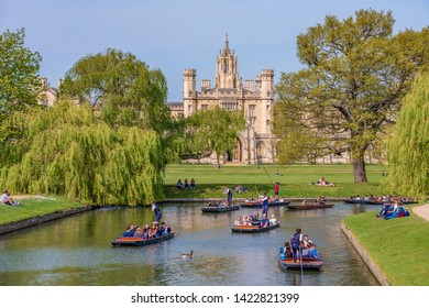 CAMBRIDGE, UNITED KINGDOM - APRIL 18: Scenic view of traditional punt boats along the River Cam with traditional British architecture in the distance on April 18, 2019 in Cambridge