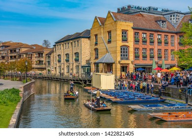 CAMBRIDGE, UNITED KINGDOM - APRIL 18: View of traditional British architecture and the river cam with punting tour boats in the town center area on April 18, 2019