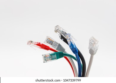 Cambridge, United Kingdom - Circa March 2018: Close-up of multicoloured Ethernet networking patch leads showing detail of the plugs and sheathing. Used for computers to a network or LAN.