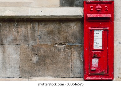 CAMBRIDGE, UNITED KINGDOM - FEBRUARY 27, 2016: A British Post Box set into the walls of a University of Cambridge building.