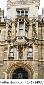 Cambridge / United Kingdom - March 18 2017: Detail of the exterior of medieval building on the corner of Trinity Street and Senate House Passage, next to King's College and Gonville and Caius College.