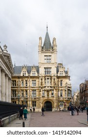 Cambridge / United Kingdom - March 18 2017: Facade of the medieval building on the corner of Trinity Street and Senate House Passage, next to King's College and Gonville and Caius College.