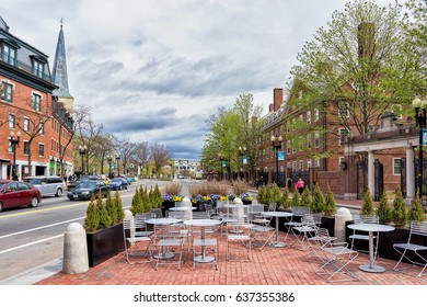 Cambridge, USA - April 29, 2015: Street cafe in Cambridge, Massachusetts, USA. People on the background