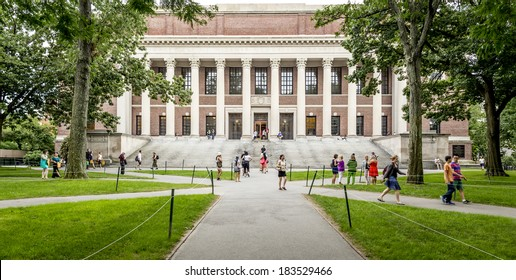 CAMBRIDGE, USA - JULY 12: View of the campus of the famous Harvard University in Cambridge, Massachusetts, USA with some students, locals, and tourists passing by on July 12, 2013.
