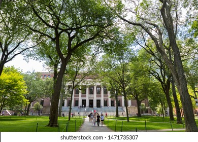 CAMBRIDGE, USA - JULY 14: View of the campus of the famous Harvard University in Cambridge, Massachusetts, USA with some students, locals, and tourists passing by on July 14, 2019.