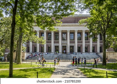 CAMBRIDGE, USA - JUNE 2: Panorama of the Harvard University's campus in Cambridge, MA, USA showcasing its historic architecture, gardens and students passing by on June 2, 2014.