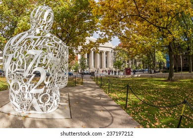 CAMBRIDGE, USA - NOVEMBER 10: Panoramic view of Cambridge in MA, USA showcasing the famous MIT campus in the fall season with locals and students passing by on November 10, 2014.