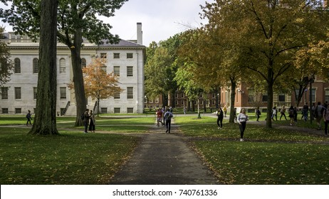 CAMBRIDGE - USA - OCTOBER 23: The architecture of the historic Harvard University in Cambridge, MA, USA with locals, tourists, and students passing by on October 23, 2017.