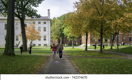 CAMBRIDGE, USA - OCTOBER 23: The architecture of the famous Harvard University on Cambridge, Massachusetts, USA with some locals and students passing by on a sunny Autumn day on October 23, 2017.