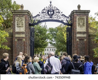 CAMBRIDGE, USA - OCTOBER 23: One of the gated of the famous Harvard University in Cambridge, MA, USA with lots of locals and international students having a tour on October 23, 2017.