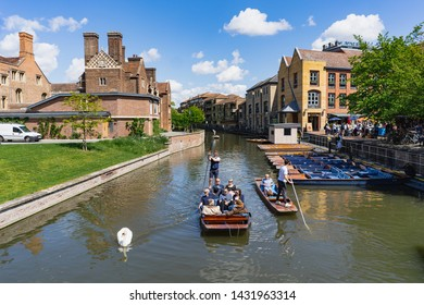 Cambridge,England, UNITED KINGDOM - May 2019: Traditional punting tour boats at the River Cam outside the famous Trinity College on May 12, 2019 in UK
