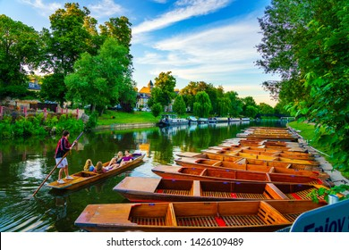 Cambridge,England-June 2019: Tourists punting at the river Cam in Cambridge city in England