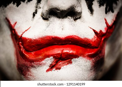 Cambridgeshire, England - July 30th 2018: A 1/1 scale life size face cast of the late actor Heath Ledger as his character 'The Joker' in the 2008 Batman movie 'The Dark Knight'.
