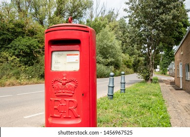 Cambridgeshire, UK - Circa July 2019: Detailed view of an unusual styled, tradition British Royal Mail post and letter box at the entrance to an industrial estate.  Collection timetable is visible.