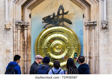 "CAMBRIDGE,UK-SEPTEMBER 3,2017:Tourists looking at John Taylor's Corpus Clock which features an insect named Chronphage  ""Time Eater"". The clock is arguably the most valuable public clock in the world"