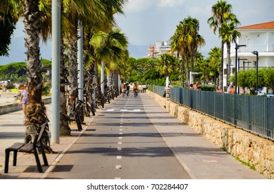 CAMBRILS, SPAIN, AUGUST 16 2017: A day before. A beautiful calm summer day in coastal town of Cambrils, bikers and walkers, nothing points that terrorist attack will happen just day later.