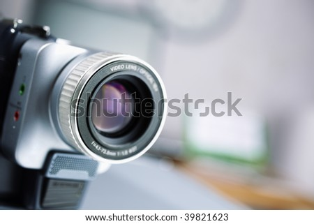 camcorder in closeup ,selective focus on nearest metal part