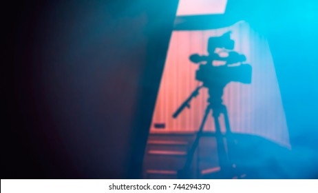 Camcorder on the Tripod Stands Before Shooting, Blur Background
