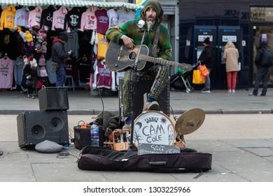 Camden, London / UK - Febuary 2 2019: Male guitarist busking in Camden Town