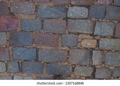Camden, London / UK - Febuary 2 2019: Pattern of old flagstones, bricks in road