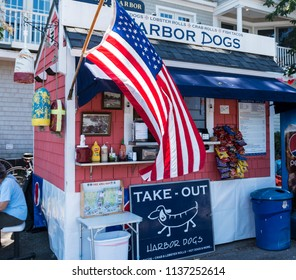 Camden, Maine, USA - 3 August 2017: Harbor Dogs hot dog stand located in a parking lot down by the harbor for locals and tourist to eat a quick meal.