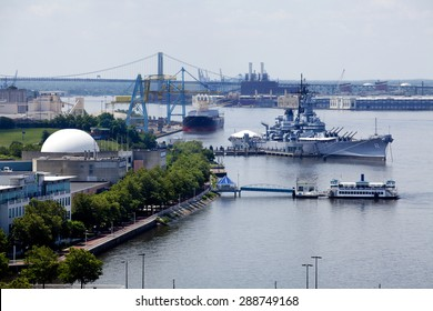 Camden, New Jersey, USA - June 14, 2015: Waterfront in Camden, New Jersey along the Delaware River with Adventure Aquarium, Battleship New Jersey, and Port of  Camden, New Jersey, USA - June 14, 2015