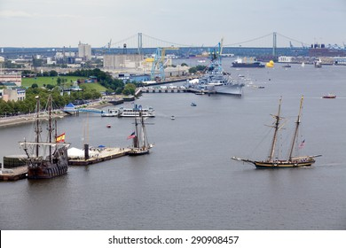 """Camden, New Jersey, USA - June 25, 2015: Tall sailing ships coming into port on the waterfront in Camden, New Jersey as part of the """"Parade of Sails"""" Tall Ships event on June 25, 2015"""
