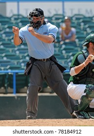 CAMDEN, NJ - MAY 27: The home plate umpire calls a strike on a pitch during an Atlantic 10 baseball tournament game between Charlotte and Rhode Island on May 27, 2011 in Camden, NJ.