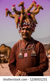Camel Man Ashok is from Rajasthan, shot on November 15, 2018 in Pushkar, Rajasthan. He is famous in the pushkar fair as he decorates his camels traditionally in the fair.
