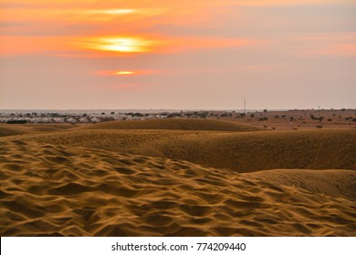 Camel safari in desert at sunset