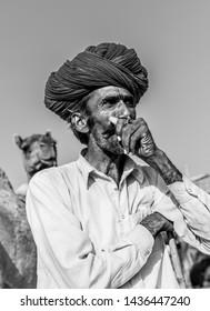 Camel Trader posing for Pic during the Camel festival : Pushkar, Rajasthan/India - Oct 2017
