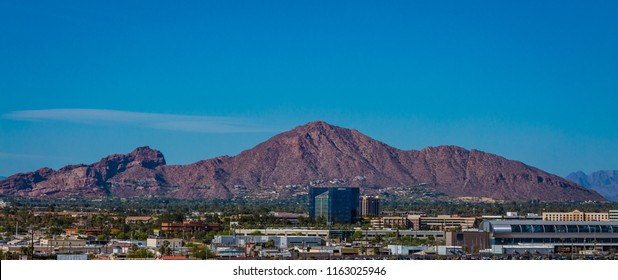 Camelback mountain is an icon that sits in the middle of bustling Phoenix, Arizona. It got its name because it looks like a camel laying down. Blue skies are a backdrop