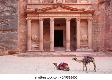 Camels, or rather dromedaries (Camelus dromedarius), waiting for tourists at Al Khazneh (the treasury) 2nd-3d Century AD. Most famous building of the ancient Nabatean city of Petra, Wadi Musa, Jordan.