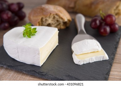 Camembert with bread and red grapes