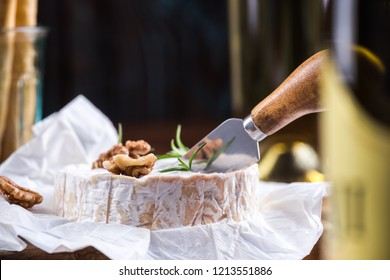 Camembert cheese cut by cheese knife.