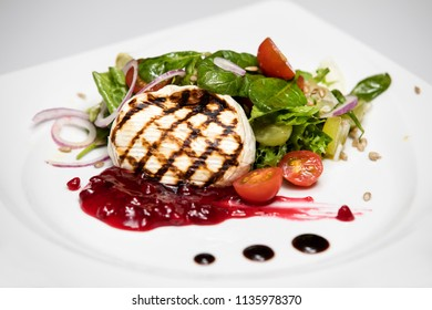 Camembert cheese. Grilled camembert cheese with vegetables