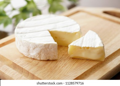 Camembert cheese on a cutting board.