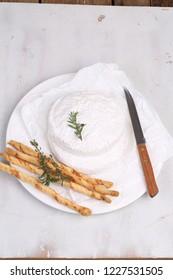 Camembert with grissini chopsticks. Camembert cheese