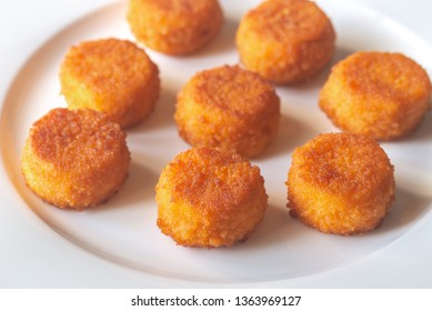 Camembert nuggets on the white plate