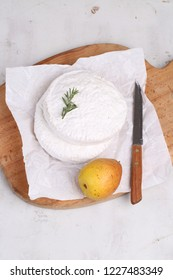 Camembert with pear on a white background. Camembert cheese