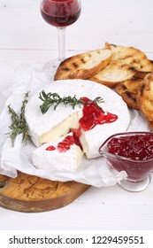 Camembert with red wine. Camembert cheese