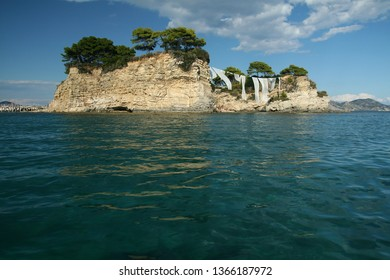 Cameo Island,  the most picturesque place in Laganas Bay, with pine trees growing in the rocks and  white cloth blowing in the wind, Agios Sostis, Zakynthos, Greece