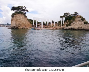 Cameo Island, Zakynthos Island, Greece - June 16, 2018: Cameo Island is available through a picturesque wood bridge in the port of Agios Sostis, next to Laganas Resort, in Zakynthos Island.