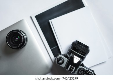 Camera With books and laptop