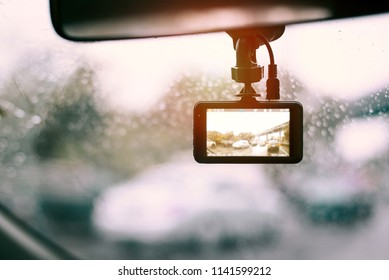 A camera in car has on and recording for the traffic jam in the rainny dday,copy space.