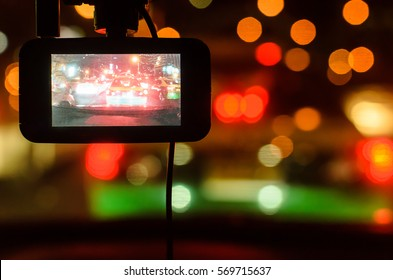 A camera in car has on and recording for the traffic jam with bokeh background in the night.